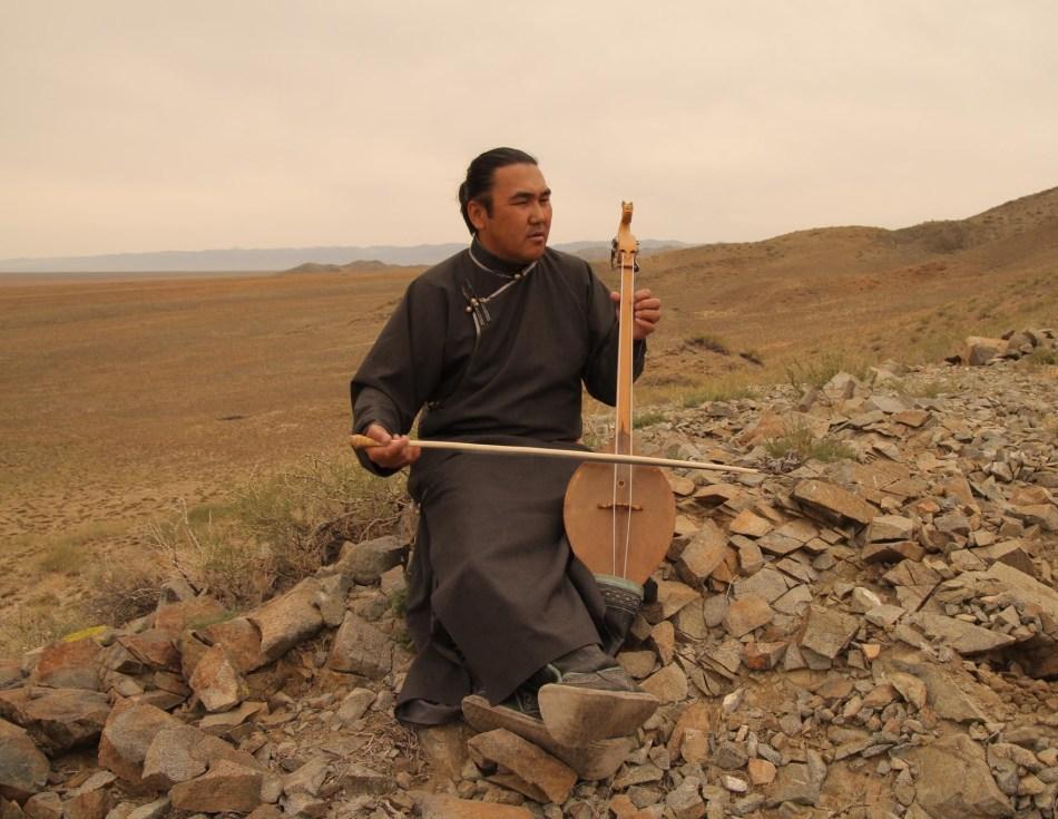 "Radik Tyulyush is playing Tuvan instrument ""igil""."